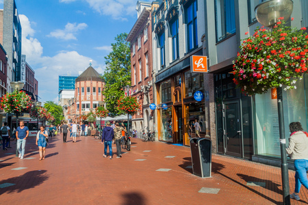 EINDHOVEN, NETHERLANDS - AUGUST 29, 2016: People walk at the pedestrian street in the center of Eindhoven, Netherlands.