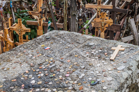 gods: SIAULIAI, LITHUANIA - AUGUST 18, 2016: Detail of crosses and coins at The Hill of Crosses, pilgrimage site in northern Lithuania