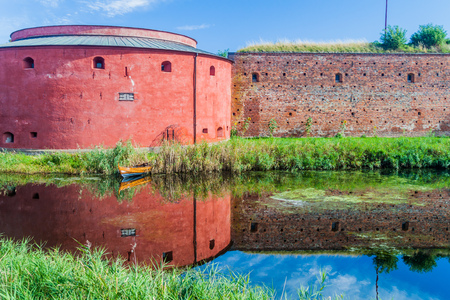 Fortification walls of Malmo Castle reflecting in its moat, Sweden