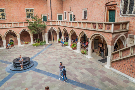 KRAKOW, POLAND - SEPTEMBER 3, 2016: People visit Collegium Maius (Great College) courtyard of the Jagellonian University in Krakow.