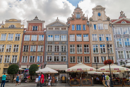 GDANSK, POLAND - AUGUST 31, 2016: People walk along historic houses at Dlugi Targ square in Gdansk, Poland