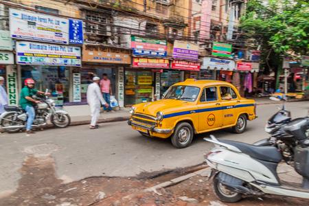 KOLKATA, INDIA - OCTOBER 27, 2016: View of yellow Hindustan Ambassador taxi in the center of Kolkata, India