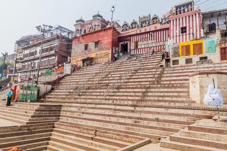 benares: VARANASI, INDIA - OCTOBER 25, 2016: View of Kedar Ghat (riverfront steps) leading to the banks of the River Ganges in Varanasi, India