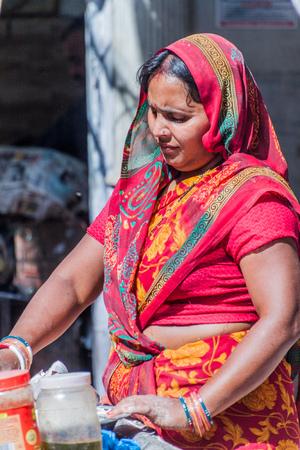 DELHI, INDIA - OCTOBER 22, 2016: Female street cook in the center of Delhi, India. Editorial