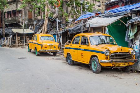KOLKATA, INDIA - OCTOBER 31, 2016: View of yellow Hindustan Ambassador taxis in Kolkata, India