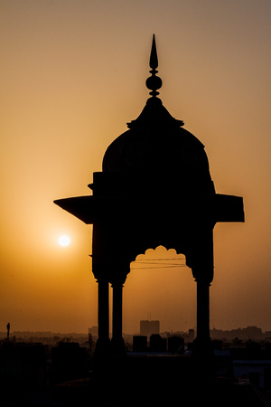 Small tower of Jama Masjid mosque in the center of Delhi during sunset, India.