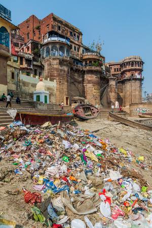 VARANASI, INDIA - OCTOBER 25, 2016: Pile of trash at a Ghat (riverfront steps) of sacred river Ganges in Varanasi, India Editorial