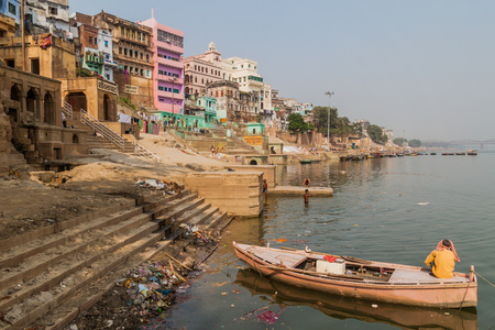 VARANASI, INDIA - OCTOBER 25, 2016: View of Lal Ghat (riverfront steps) of sacred river Ganges in Varanasi, India