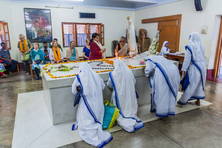 KOLKATA, INDIA - OCTOBER 30, 2016: Sisters of The Missionaries of Charity pray at Mother Teresa tomb in Mothers House in Kolkata, India.