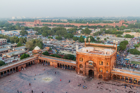 DELHI, INDIA - OCTOBER 22, 2016: Courtyard of Jama Masjid mosque in the center of Delhi, India. Red Fort in the background.