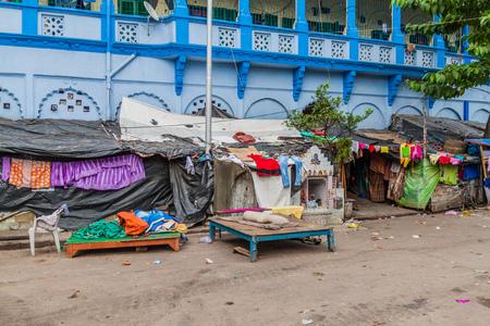 KOLKATA, INDIA - OCTOBER 31, 2016: Simple dwellings of impoverished people near Kalighat temple in Kolkata, India.
