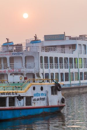 DHAKA, BANGLADESH - NOVEMBER 20, 2016: Boats at Buriganga river in Dhaka, Bangladesh