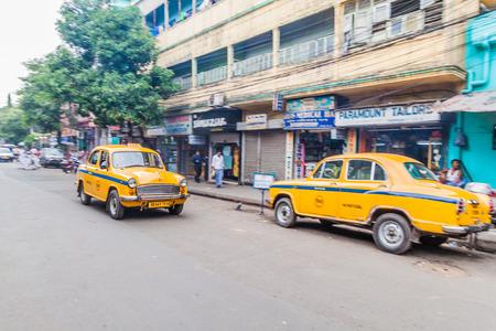 KOLKATA, INDIA - OCTOBER 27, 2016: View of yellow Hindustan Ambassador taxis in the center of Kolkata, India Editorial