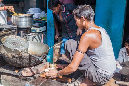 DELHI, INDIA - OCTOBER 22, 2016: Street cook in the center of Delhi, India.