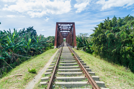 Railway bridge over Ay river in Valle de los Ingenios valley near Trinidad, Cuba Stock Photo - 92761085