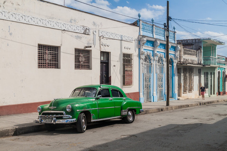 CIENFUEGOS, CUBA - FEBRUARY 10, 2016: Vintage car on a street in Cienfuegos, Cuba. Editorial