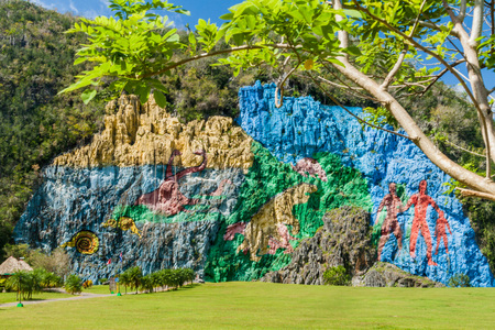 Mural de la Prehistoria (The Mural of Prehistory) painted on a cliff face in the Vinales valley, Cuba.