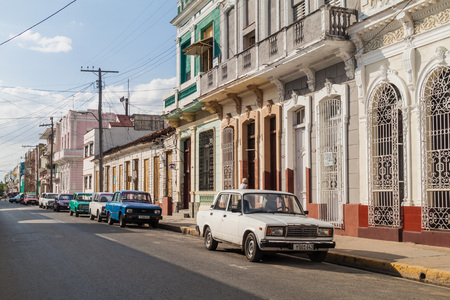 CIENFUEGOS, CUBA - FEBRUARY 10, 2016: Street with old colonial houses in Cienfuegos, Cuba. Editorial