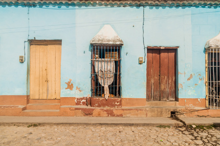 Mildly dilapidated house in the center of Trinidad, Cuba.