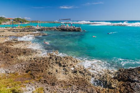 PLAYA GIRON, CUBA - FEB 15, 2016: Tourists enjoy water at the seaside resort Caleta Buena at Bay of Pigs near Playa Giron village, Cuba.