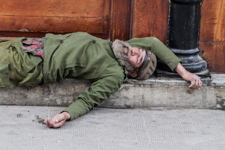 HAVANA, CUBA - FEB 22, 2016: Homeless man sleeping on the street in Old Havana. Editorial
