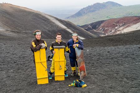 CERRO NEGRO, NICARAGUA - APRIL 26, 2016: Tourists are ready for volcano boarding from Cerro Negro volcano, Nicaragua Redakční