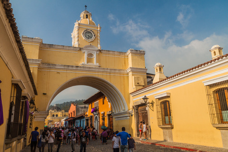 ANTIGUA, GUATEMALA - MARCH 26, 2016: View of Santa Catalina Arch in Antigua Guatemala town, Guatemala.