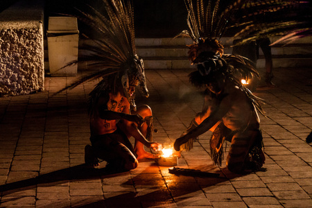 CHICHEN ITZA, MEXICO - FEB 25, 2016: Native mayan dancer performance near Chichen Itza ruins.