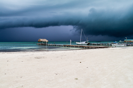 Beach in Caye Caulker village, Belize. Storm is coming. Stock Photo