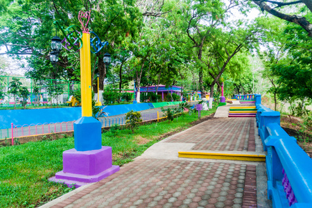 Malecon, embankment or esplanade along a waterfront of Laguna de Masaya lake in Masaya, Nicaragua Stock Photo