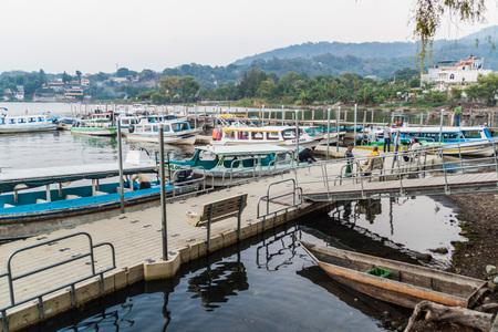 SANTIAGO ATITLAN, GUATEMALA - MARCH 23, 2016: Boats in a jetty of Santiago Atitlan village.