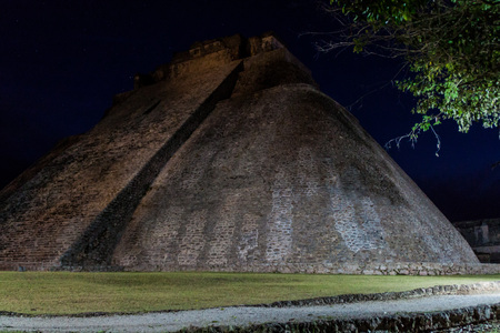 Night view of the pyramid of the Magician (Piramide del adivino) in ancient Mayan city Uxmal, Mexico Stock Photo