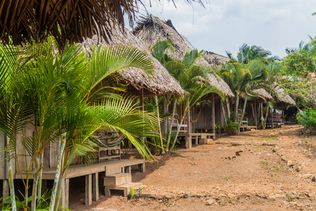 Thatched huts of a lodge near San Juan river, Nicaragua Stock Photo