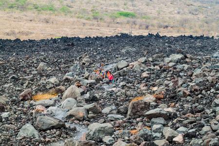 CERRO NEGRO, NICARGAUA - APRIL 26, 2016: Tourists climb to the rim of Cerro Negro volcano, Nicaragua. Volcano boarding is a popular activity here.