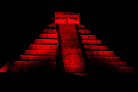 Night view of Kukulkan pyramid in ancient Mayan city Chichen Itza, Mexico