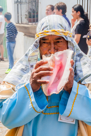 ANTIGUA, GUATEMALA - MARCH 27, 2016: Participant of the procession on Easter Sunday in Antigua Guatemala city.