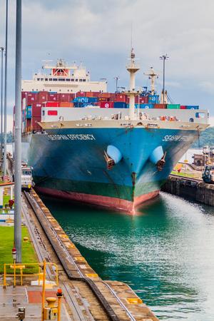 GATUN, PANAMA - MAY 29, 2016: Container ship is  passing through Gatun Locks, part of Panama Canal. Editorial