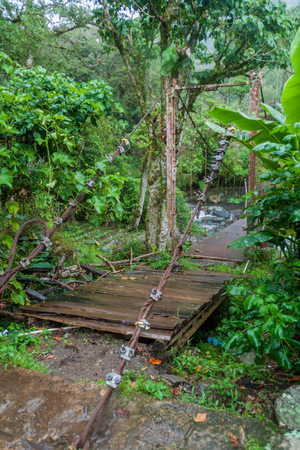 Suspension bridge over Caldera river near Boquete (Panama), on Lost Waterfalls hiking trail.