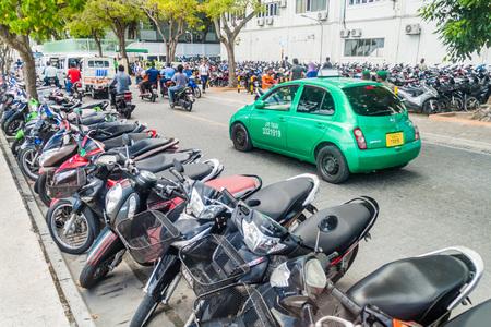 MALE, MALDIVES - JULY 11, 2016: Traffic on Boduthakurufaanu Magu street in Male. Editorial