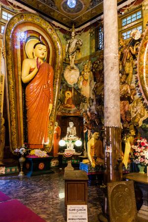 COLOMBO, SRI LANKA - JULY 26, 2016: Buddha statues in Gangaramaya Buddhist Temple in Colombo, Sri Lanka