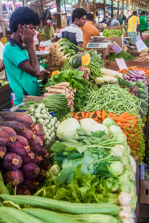 COLOMBO, SRI LANKA - JULY 26, 2016: Vegetable sellers at Self Employees Market in Colombo, Sri Lanka Editorial