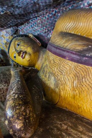 DAMBULLA, SRI LANKA - JULY 20, 2016: Buddha statue in a cave of Dambulla cave temple, Sri Lanka