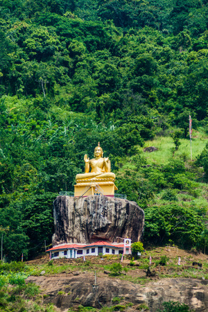 Buddha statue at a hill slope near Aluvihare Rock Temple, Sri Lanka