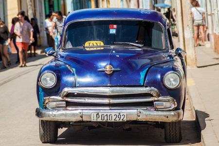 TRINIDAD, CUBA - FEB 8, 2016: Vintage Oldsmobile car on a street in the center of Trinidad, Cuba.
