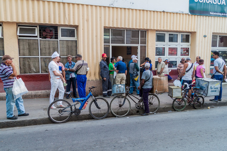 CIENFUEGOS, CUBA - FEBRUARY 10, 2016: Local people wait in a queue for bread in Cienfuegos, Cuba. Editorial