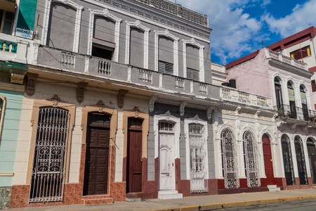 Old colonial houses in Cienfuegos, Cuba. Stock Photo - 92990131