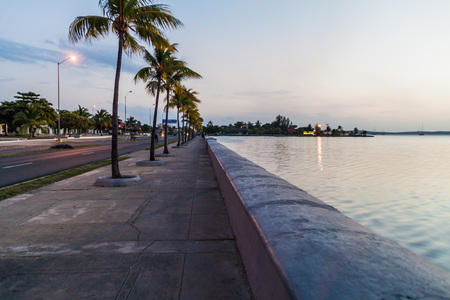 Evening view of Malecon (seaside drive) in Cienfuegos, Cuba.