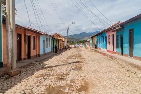 TRINIDAD, CUBA - FEB 8, 2016: View of a cobbled street in the center of Trinidad, Cuba.