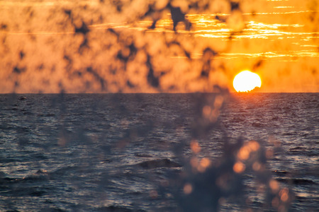 Sunset at a rough sea Stock Photo