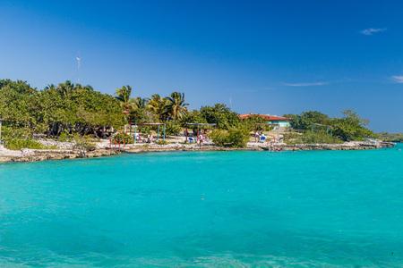 PLAYA GIRON, CUBA - FEB 15, 2016: Tourists enjoy the seaside resort Caleta Buena at Bay of Pigs near Playa Giron village, Cuba.